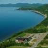 Aerial view of the Miguasha Museum of Natural History, the cliff and the estuary of the Ristigouche river.