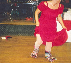 A wedding goer dancing the sock dance in Ontario, circa 1983