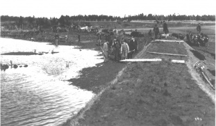 Workers Building a Levee and an Aboiteau-style dike (1900)