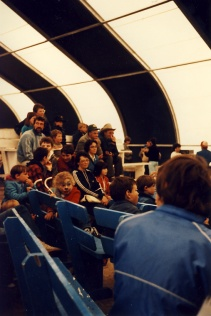 Spectators inside the marquee at the 6th annual Fête Fransaskoise in Batoche in 1985