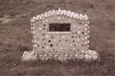 Concrete grave marker decorated with shells and beach glass, dedicated to David Joseph Marchand (1956), old Saint-Louis cemetery in Louisdale, Cap Breton. Photo D. Trask © S. Ross