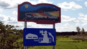 A welcome sign advertising the Sainte-Sophie Municipality's tourist attractions