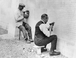 Engraving the names of the fallen on the base of the Canadian War Memorial at Vimy