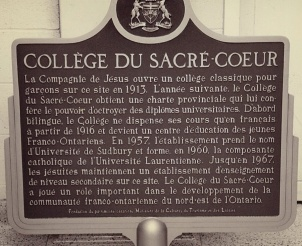 A plaque tells the history of the college