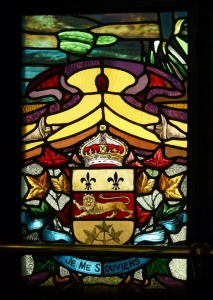Quebec's coat of arms on the stained glass adorning the entrance to Le Parlementaire Restaurant