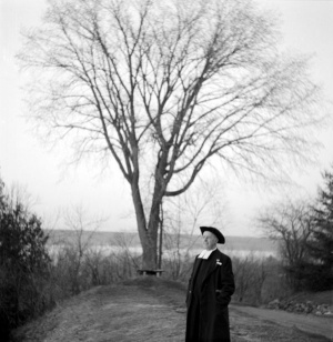 Brother Stephen, in 1950, standing near an elm tree planted on the first Arborr Day, in 1877, on the estate of Henri-Gustave Joly de Lotbinière