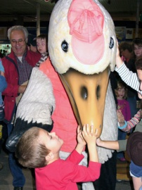 A youngster with Pampan, mascot of Montmagny's Snow Goose Festival, 2007