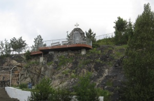 View of the Shrine on its rock overhang taken from foot the hill