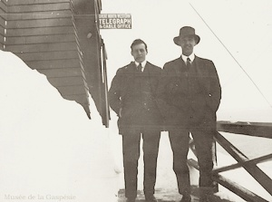 At Pointe-à-la-Renommée, two operators in front of the telegraph station of Great North Western Telegrah & Cable