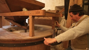The miller at the Légaré Mill adjusts the mix for buckwheat flour