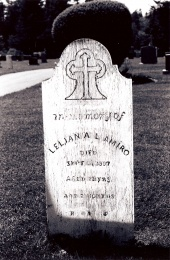 Wooden grave marker dedicated to Lelian A L Amiro [Amirault] who died in 1897 at the age of 22 years 2 months. Photo D. Trask © S. Ross