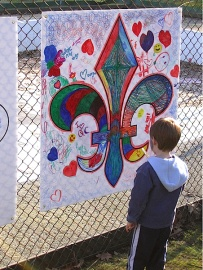 Child looking at a mural at the Festival du Bois, Maillardville, 2008