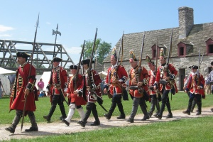 Reenactors commemorating the surrender of Fort de Chartres in 1765 to the 42nd Royal Highland Regiment.
