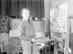 The painter E. Holgate before one of his Lac-Tremblant landscape paintings, © BAnQ
