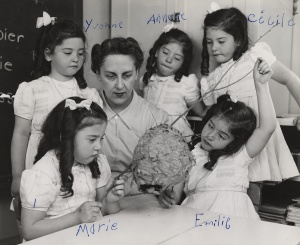 Gaëtane Vézina, surrounded by the famous Dionne quintuplets, who signed their names on the original photograph, Callander, Ontario, between 1938 and 1942