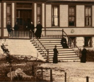 Society members pose for a photograph in front of the early college in 1890 (detail)